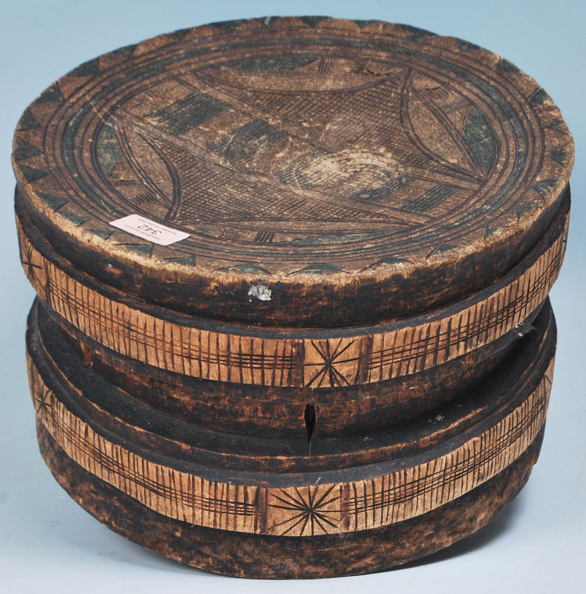 Los 342 - An African tribal Lega low circular stool from the Democratic Republic of the Congo having an...