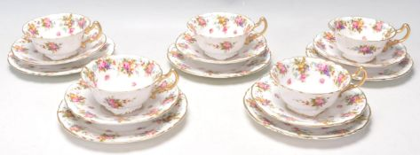 An early 20th Century Edwardian antique Royal Doulton fine bone china tea service decorated with