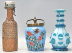 A collection of glassware to include a vintage Bohemian flash cut blue and white bottle vase, a