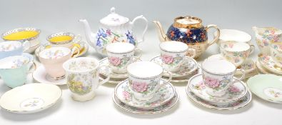 A collection of mixed vintage bone china tea service items, brands include Foley, Royal Doulton,