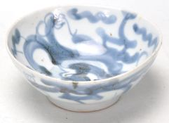 An 18th Century Japanese oriental blue and white footed bowl decorated with hand painted dragon