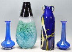 A selection of vintage retro studio art glass to include a blue and yellow cased glass vase with