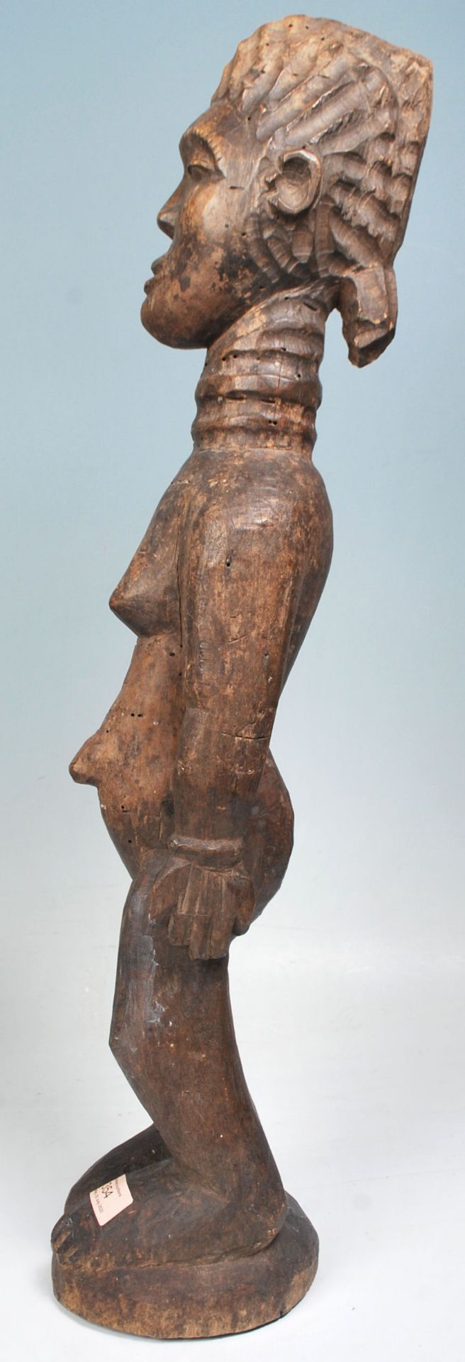 Los 354 - A carved African tribal wood fertility figure having a ringed neck and extended belly button,...