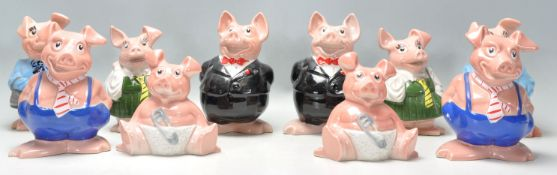 A collection / set of 20th century Wade Nat West Pigs ( see illustrations ). Measurements: 18 cm