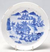An 18th Century Kangxi Chinese blue and white hand painted dish of round form being finely painted