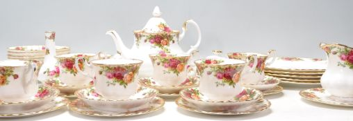 A Royal Albert bone china tea service in the Old Country Roses pattern to include a teapot, dinner