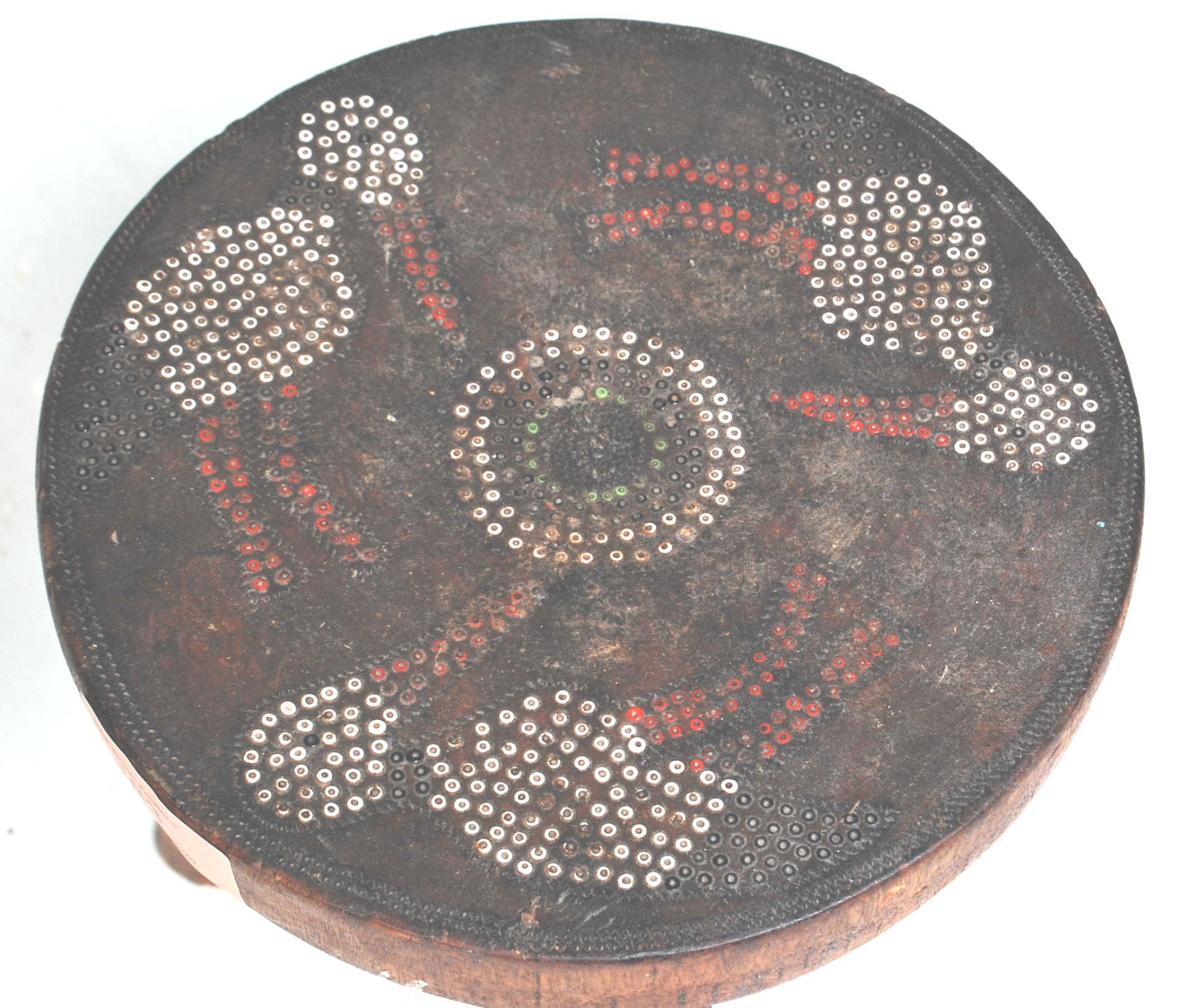 Los 383 - An Australian aboriginal wooden tribal stool having a around seat with three carved legs below,...