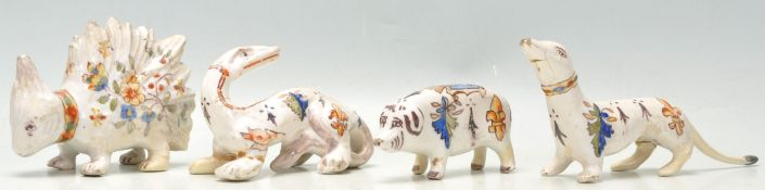 A group of four antique French quimper faience pottery animal figurines, each being hand painted