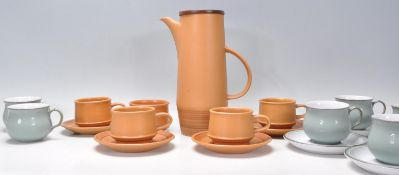 A vintage retro 20th Century Purbeck pottery coffee service consisting of four brown glazed coffee
