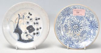 An 18th Century Japanese blue and white small plate having hand painted decoration of a perched bird