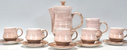 A vintage retro 20th Century Rye pottery coffee service consisting of coffee pot, six cups and