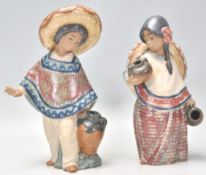 A pair of Lladro ceramic figurines in the form of a Mexican boy wearing a Sombrero and a poncho
