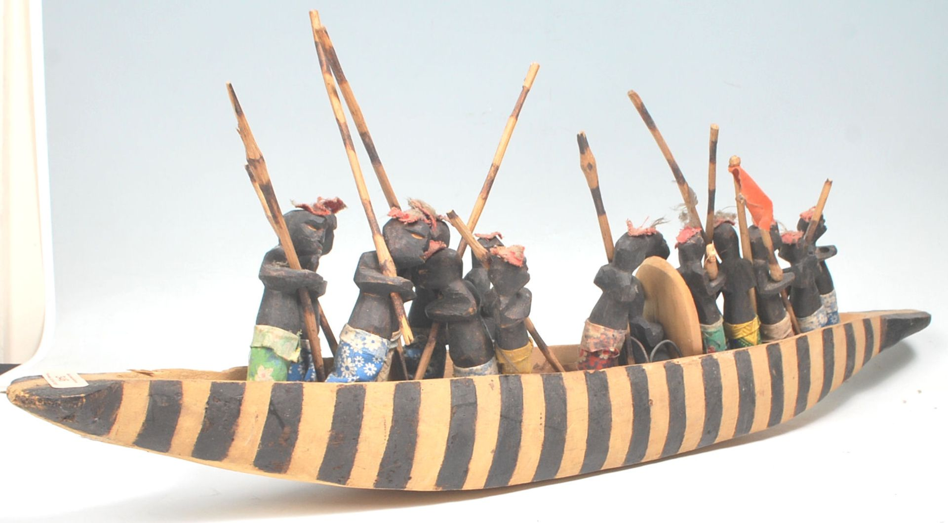Los 346 - An African tribal carved wooden boat figurine complete with striped painted sides, complete with...