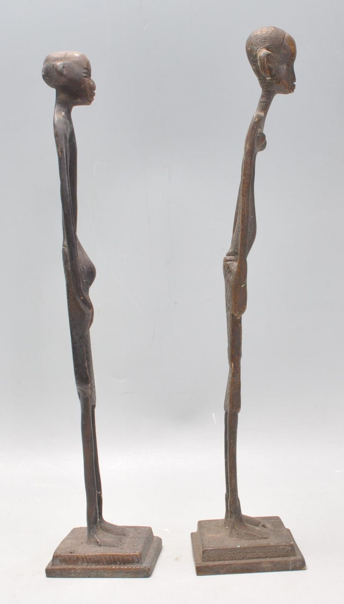 Los 270 - A pair of vintage 20th Century Tribal African bronze fertility figures of slender form. Raised on...