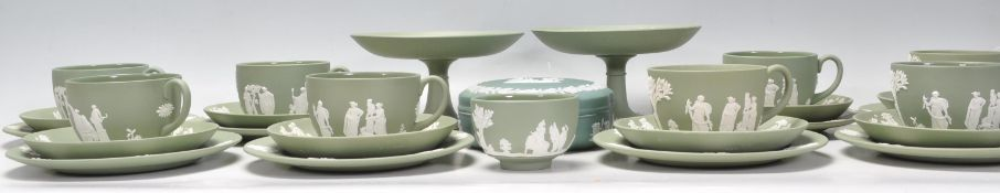 A Wedgwood Green Jasperware tea service compressin