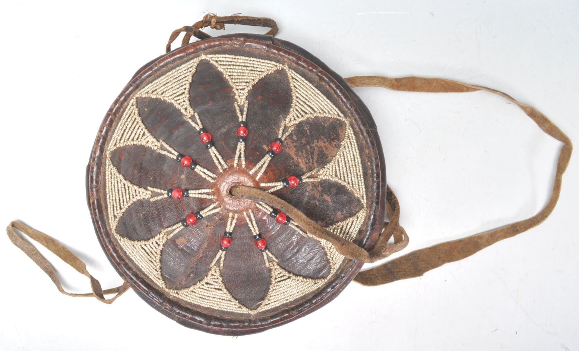 Los 387 - An early 20th Century Vintage tribal Ethiopian injera bread basket. Leather covered with beadwork...