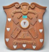A vintage wooden wall plaque British Brewood Cann