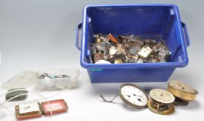 A collection of vintage spare watch and clock part