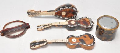 A group of antique tortoise shell ornaments to inc