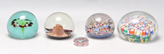 A group of five glass paperweights to includemill