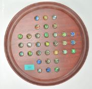 A 20th Century solitaire board game having a full