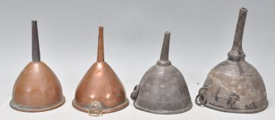 A group of four wine funnels dating from the 18th
