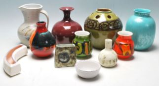 A collection of retro 20th Century studio art Poole pottery to include ceramic green glazed vase