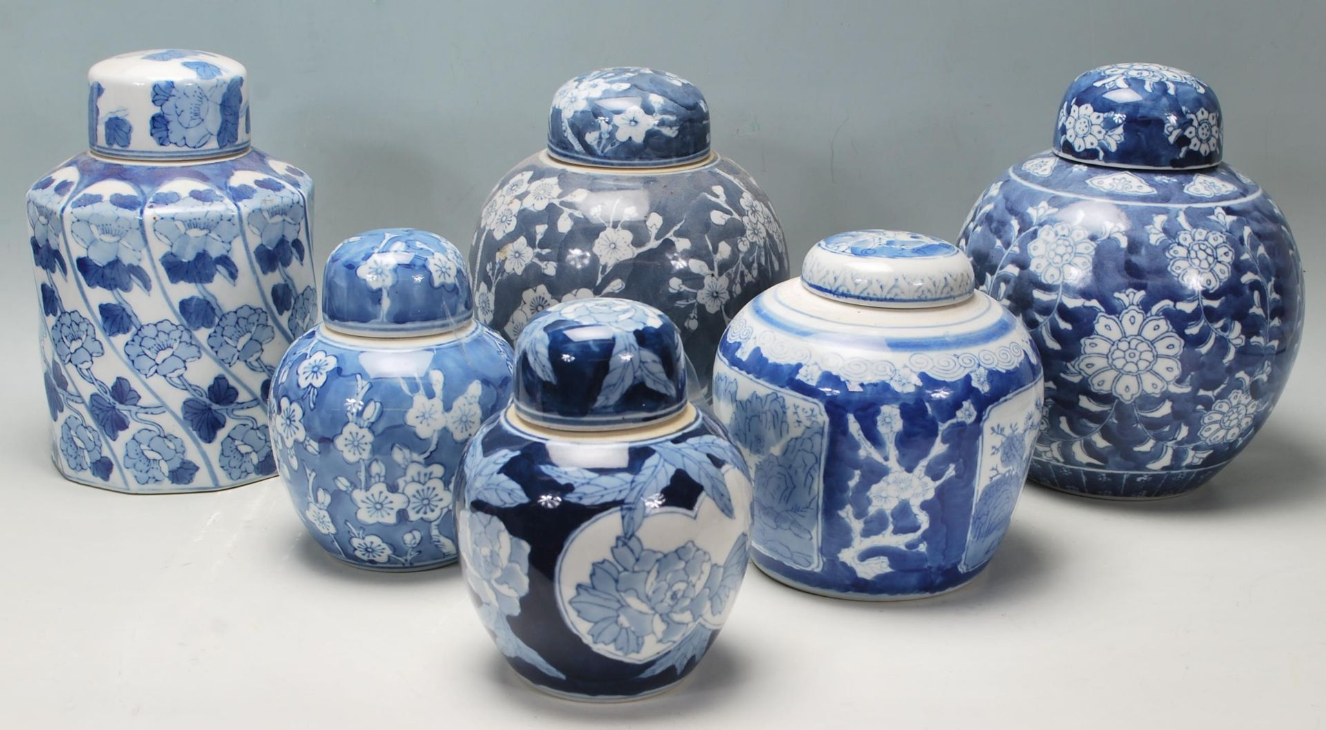 Los 111 - A group of 20th Century Chinese blue and white ginger jars to include three prunus pattern