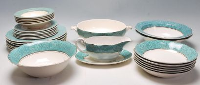 A vintage retro Wedgwood Garden pattern dinner service having a white ground with green circular