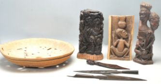 A collection of vintage African tribal artefacts to include a pair of tribal spearheads, an ebony