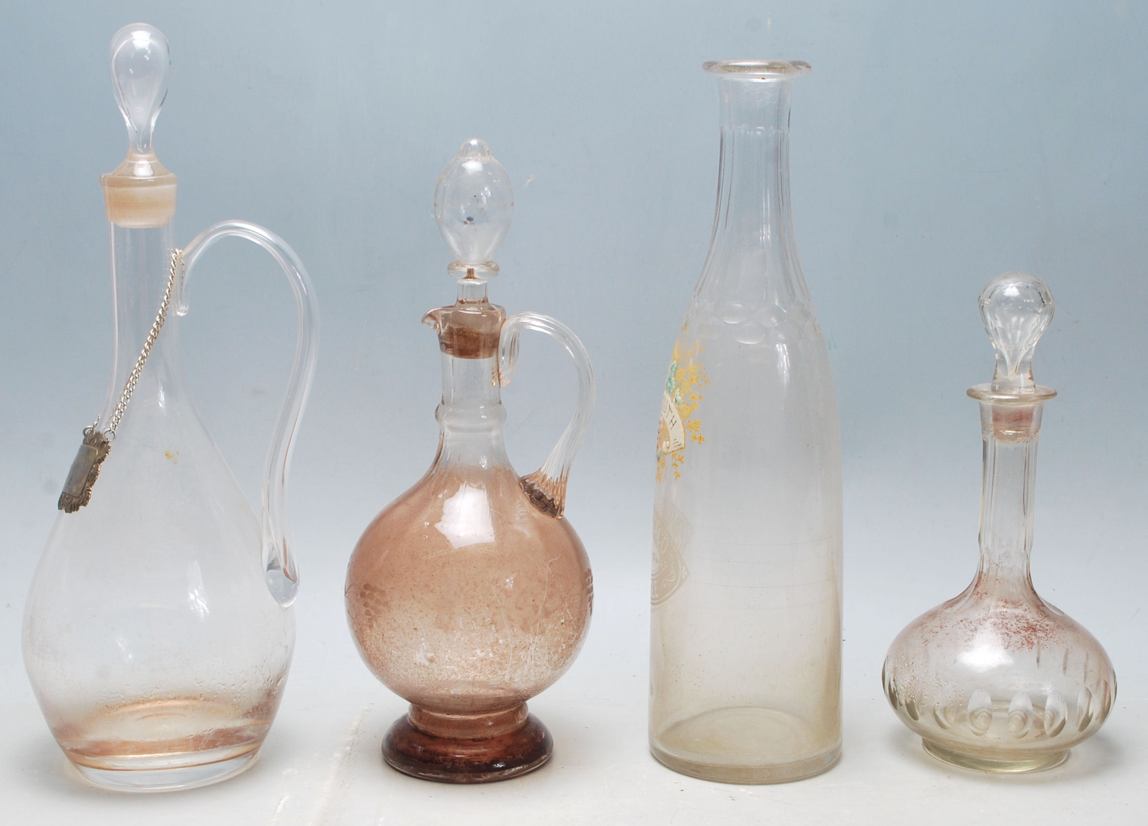 Lot 39 - A collection of 18th century and 19th century Victorian glass decanters to include a two jug