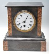 An Antique 20th Century Marble slate mantel clock having a flared top over a white enamel face and