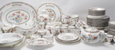 An extensive Wedgwood Kutani crane dinner and tea service consisting of dinner plates, side