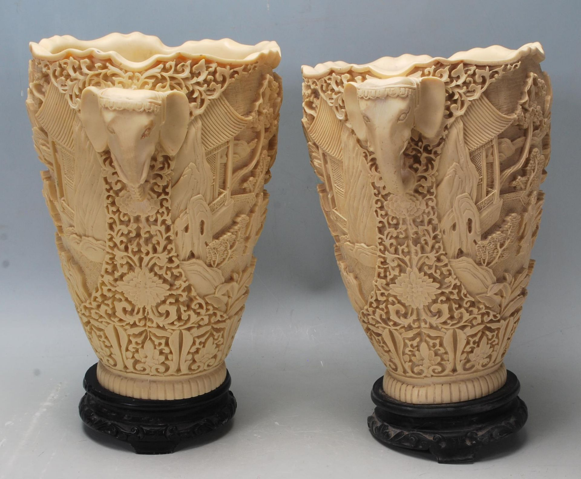 Los 211A - A pair of early 20th Century Chinese resin vases having raised landscape scenes to the body and