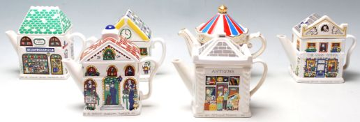 A collection of six 20th century retro teapots made by Wade being modelled in a vintage and