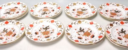A group of vintage Royal Crown Derby Asian Rose pattern plates each being decorated with red and