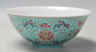 A vintage 20th Century Chinese bowl decorated with floral, butterfly and Shou emblem designs on a