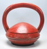 A 20th Century Chinese wooden box of round domed form having a large carved wooden domed handle to