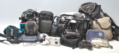 A collection of vintage retro camera equipment to include a Pentax P30, Lumix FZ38, SMC PENTAX- A