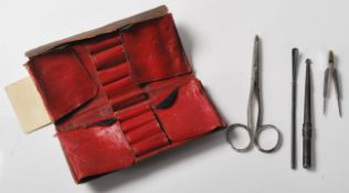 A collection of antique early 20th Century medical instruments, two of which marked Evans,