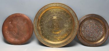 A group of three Cairo ware Egyptian metal wall charger plates to include a large brass plate