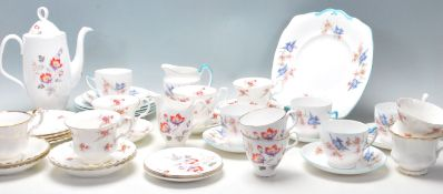 A selection of Royal Albert English bone china tea sets to include Rose Time pattern tea cups,