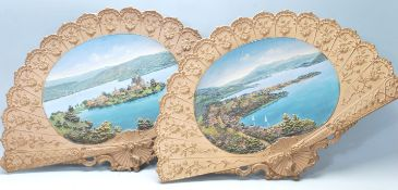 Two 20th Century ceramic wall mounting fans / chargers each having moulded raised decoration with