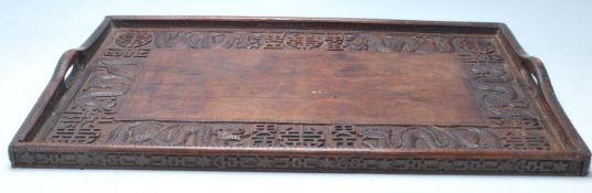 An early 20th Century Chinese Qing Dynasty style carved hardwood rice wine serving tray decorated