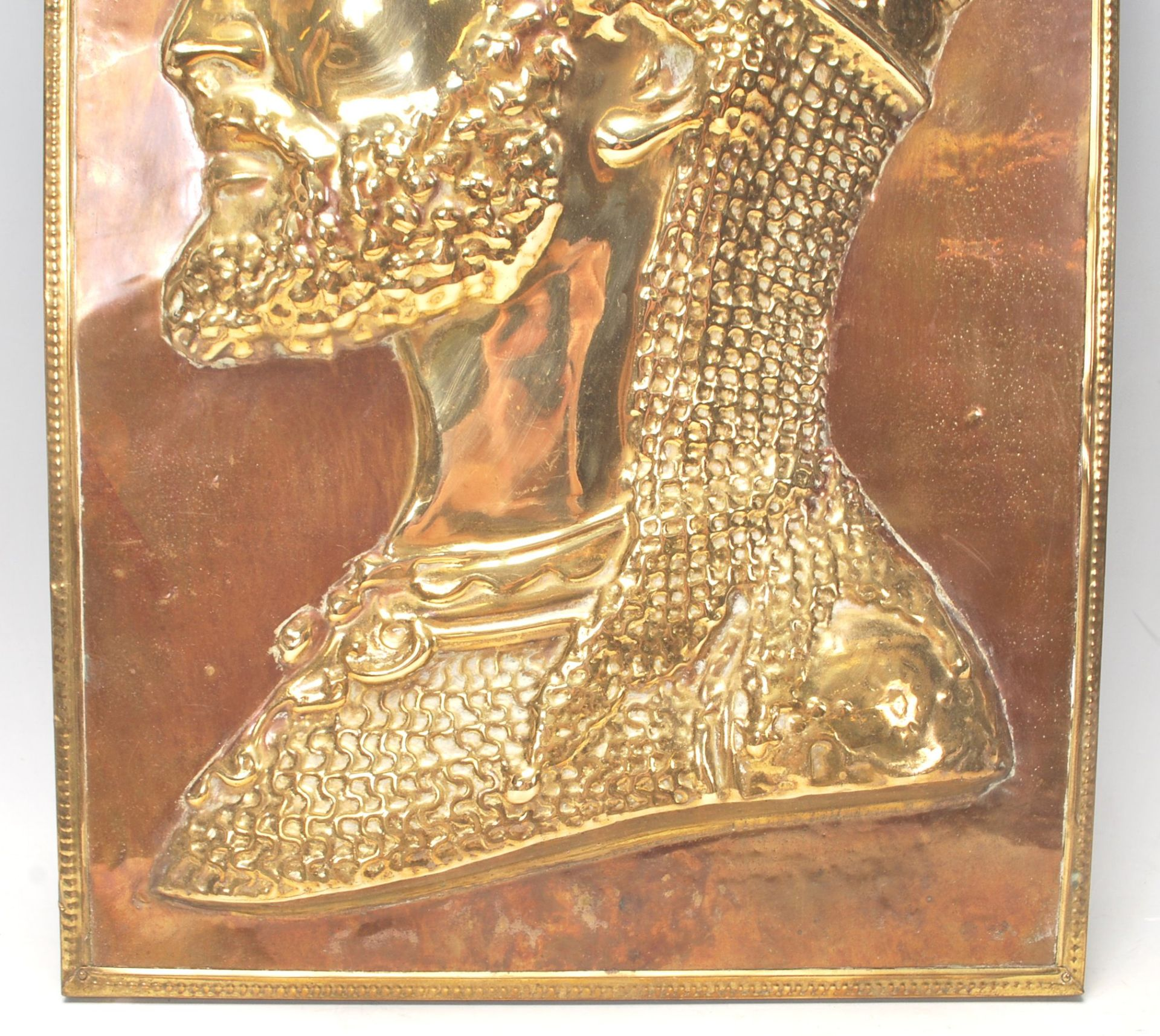 Los 223 - An vintage early 20th Century Islamic brass picture of a Syrian / Ottoman soldier in profile set