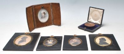 A selection of 19th Century Victorian silhouettes and portraits all related to the same family to
