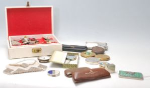 A collection of various 20th Century items to include ladies compacts with decoration at the top,