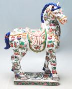 A 20th Century Chinese oriental Tang horse statue in the manner of Tang Dynasty with famille verte