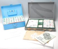 Two mid 20th Century Oriental Mahjong set, one set having plastic pieces with clear flower