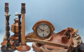 A collection of mid-century woodenware to include a pair of mahogany tall twisted candlesticks,